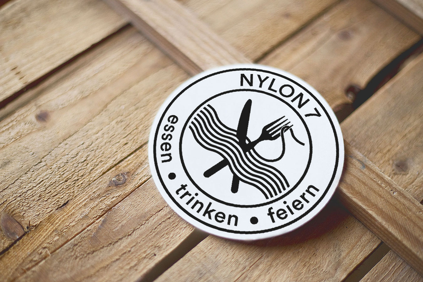 IG Arbeit Nylon 7 Logo Bierdeckel